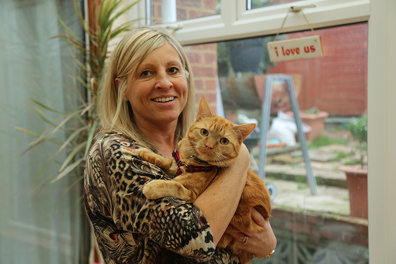 Ginger cat Jersey with mum at home