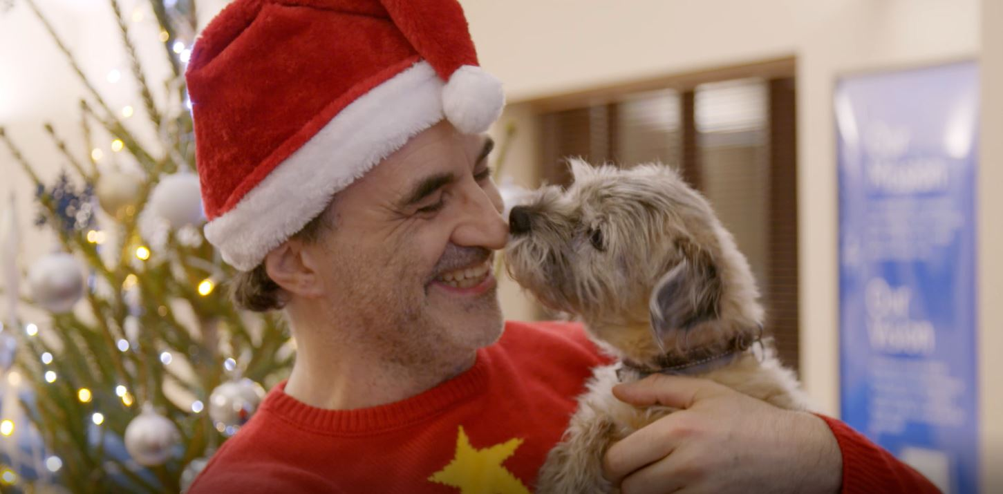 Noel Fitzpatrick and Border Terrier Keira at Christmas